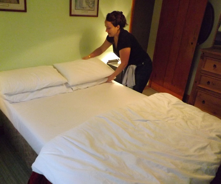 Melanie making a guest bed at Exmoor Cottage Holidays in Exmoor, North Devon