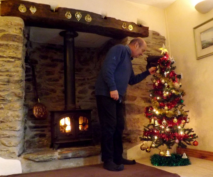 John preparing a Christmas tree at Exmoor Cottage Holidays in Exmoor, North Devon