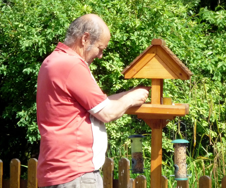 John feeding the birds at Exmoor Cottage Holidays in Exmoor, North Devon