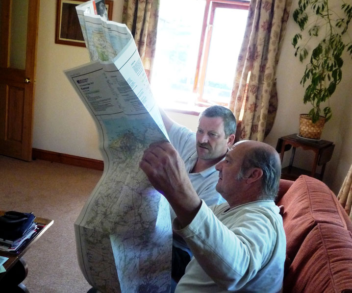 John showing a guest some good walks at Exmoor Cottage Holidays in Exmoor, North Devon